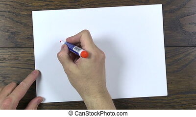 drawing a house - man hand drawing a house with orange...