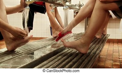 Boys at public bath - Scrubbing feet