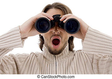astonished male watching through binocular on an isolated...