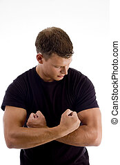 young man showing his muscles against white background