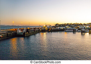 town and harbor of Playa Blanca from seaside in the evening...