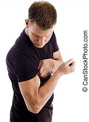 muscular man showing his muscles on an isolated background
