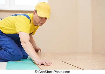 cork worker at flooring work - One carpenter worker laying...