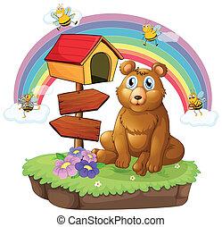 A bear beside a wooden mailbox and a wooden signboard -...