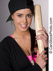 Pretty Female Baseball Lover Holds A Wooden Bat and Smiles