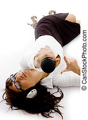 high angle view of businesswoman lying down holding a...