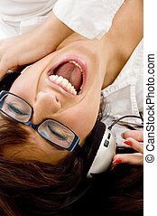 close up view of female enjoying music with headphones