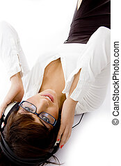 close up view of female enjoying music with headphones...