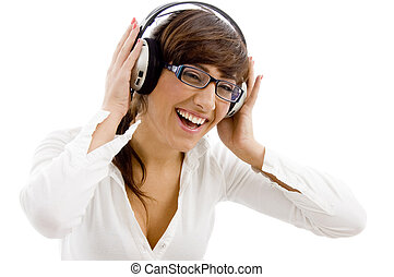 front view of smiling female listening music with headphone...