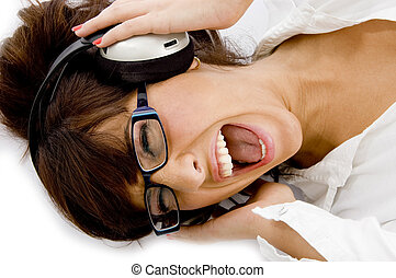 high angle view of woman enjoying music with white...