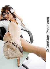 side angle view of female attorney listening to music