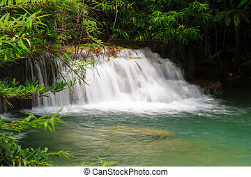 Beautiful waterfall in rainforest , Kanchanaburi Province ,...