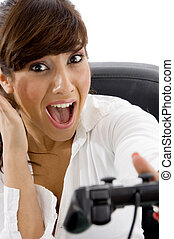 front view of excited businesswoman playing videogame -...