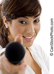 front view of female executive offering microphone