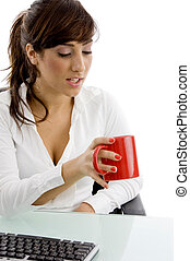 front view of attorney looking at coffee mug