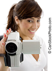 front view of smiling female shooting with handy camera