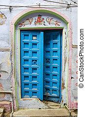 ancient blue wooden door in Varanasi,India
