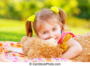 Little girl hugging soft toy - Cute smiling baby girl...