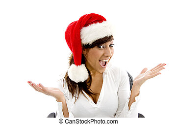 front view of happy female executive wearing christmas hat...