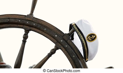 Regatta - sailors cap hanging on the old-fashioned wooden...