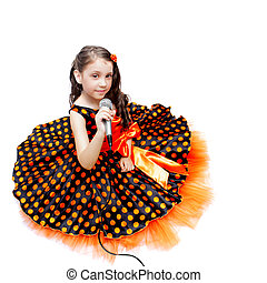 Little girl in orange peas dress with microphone