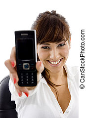 front view of smiling businesswoman showing her cell phone