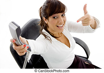 high angle view of businesswoman pointing at phone