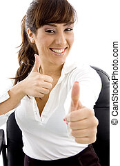 front view of smiling female attorney showing thumbs up