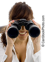 front view of smiling businesswoman looking through binoculars