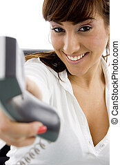 front view of happy female holding phone receiver accountant
