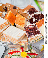 Home baked cakes - plate with the home-baked cakes and...