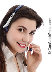Beautiful call center agent holding a mouthpiece of her...