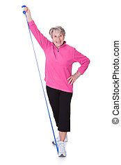 Senior Woman Stretching Exercising Equipment On White...