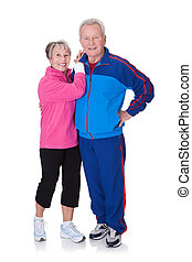 Portrait Of A Senior Couple Exercising On White Background
