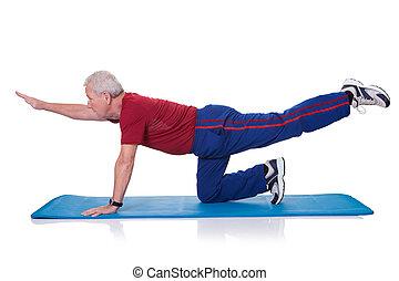 Portrait Of Senior Man Exercising On White Background