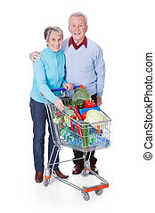 Senior Couple Shopping Vegetables - Portrait Of Happy Senior...