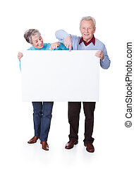 Senior Couple Holding Blank Placard - Happy Senior Couple...
