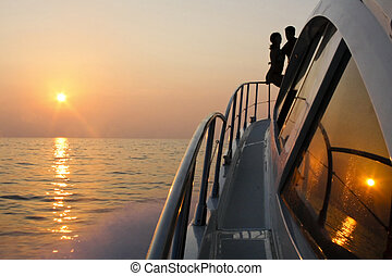 love boat silouette - two people in love romantic sunset on...