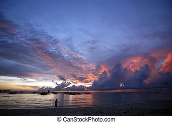 Sunset - Drifting boat on a sunset on the tropical island....