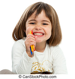 Happy girl with crayons.