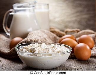 cottage cheese, eggs and jug of milk