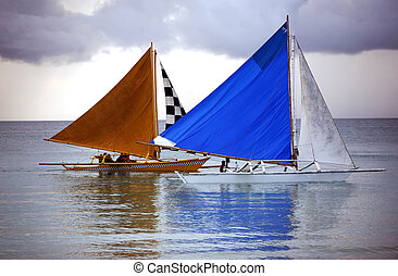 Two sailing boat at an open ocean