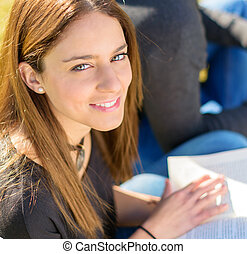 Portrait Of Young Female Student Studying; Outdoors