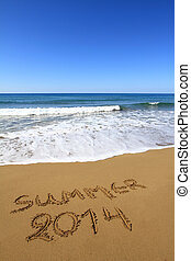 ?Summer 2014? written on sandy beach