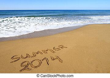 ?Summer 2014? written on sandy beach