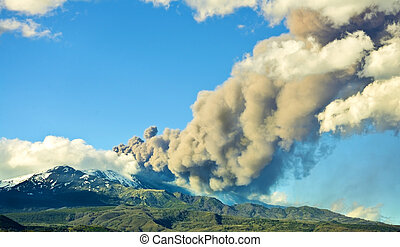Erupting volcano emits a large amount of smoke