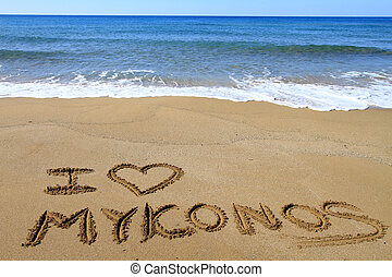 I Love Mykonos written on sandy beach