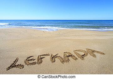 Lefkada written on sandy beach
