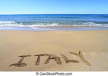 Italy written on sandy beach