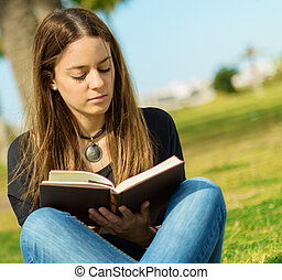 Woman Reading Book In Park - Young Woman Reading Book In...